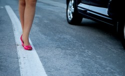 lady's feet and car on road